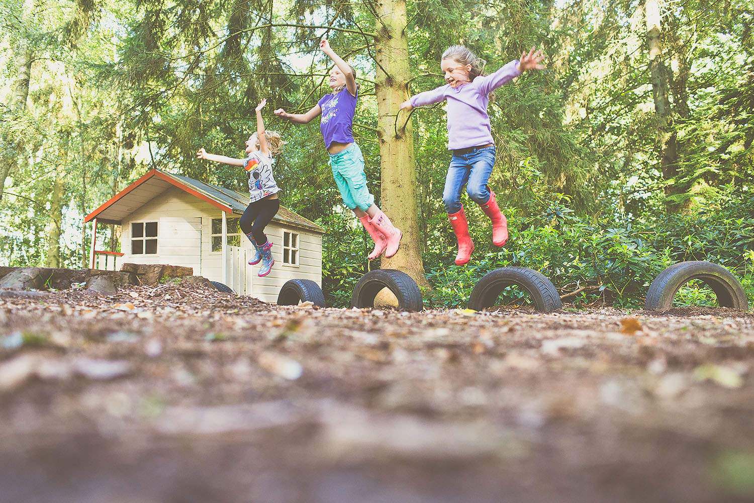Three children jumping in the air.
