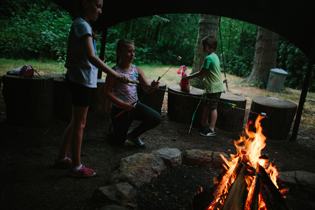 Children roasting marshmallows on a large campfire